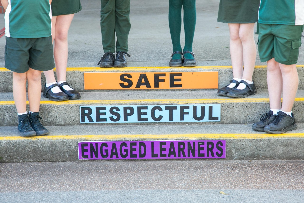 Safe respectful and engaged learners on steps